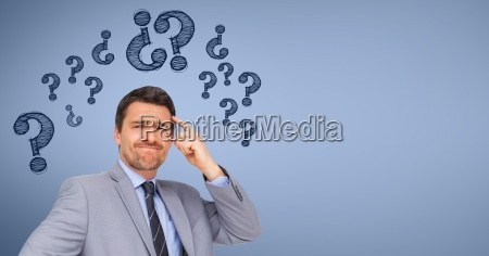 confused businessman standing with graphics over