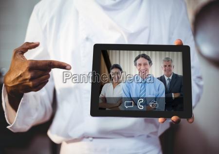 businessman having video call with colleagues