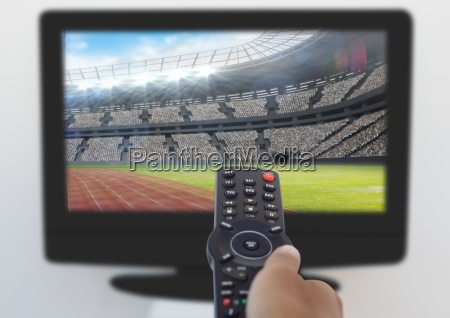 mans hand using remote control while