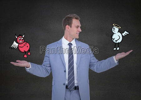 businessman standing between the good and