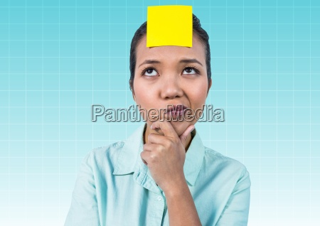 thoughtful businesswoman with blank yellow sticky