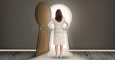 woman standing against keyhole shaped doorway