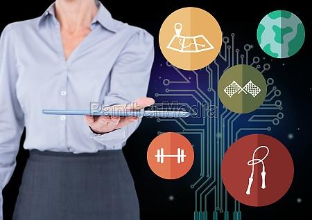 businesswoman holding digital tablet agaist application