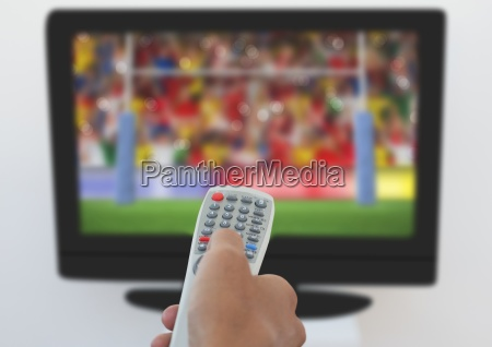 man using remote control to change