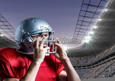 american football player removing his helmet
