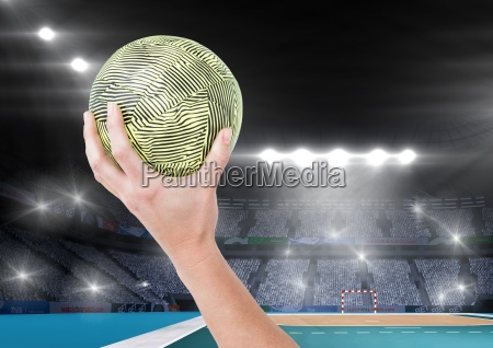 close up of hand holding ball