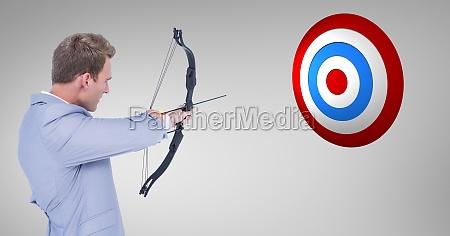 digital composite image of businessman aiming