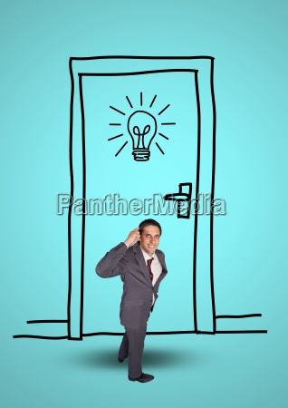 businessman standing against graphic door and