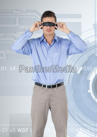 man using virtual reality headset against