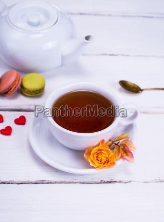 black tea in a white round