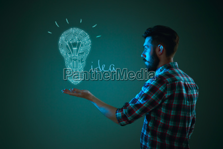 handsome young man with idea bulb