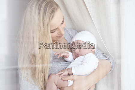 happy mother with a baby