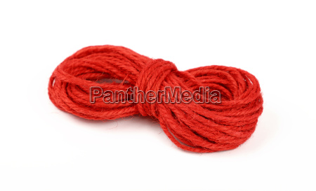 red jute twine coil skein isolated
