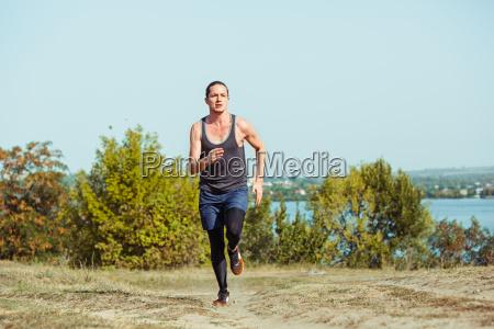 running sport man runner sprinting outdoor