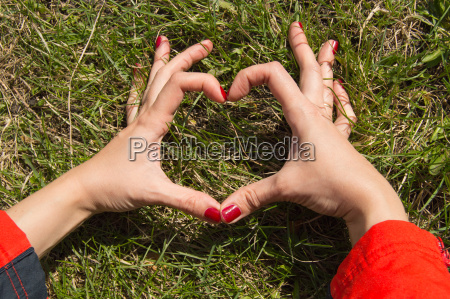 woman with beautiful manicured hands making