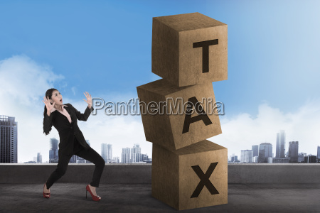 asian business woman shock looking tax