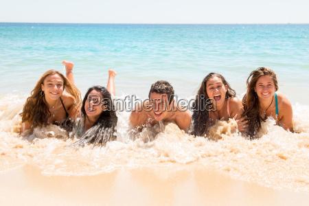 people having fun in the sea
