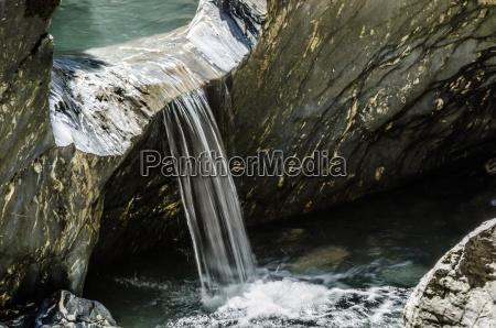 overflowing water at rocks