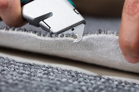 carpenter shaping carpet