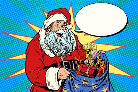 joyful santa claus with bag of