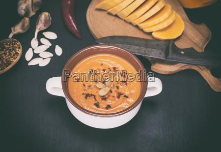 fresh pumpkin soup in a ceramic