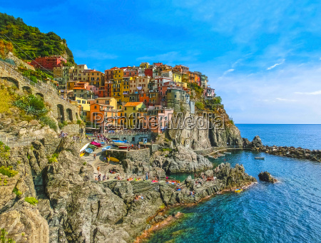 colorful traditional houses on a rock