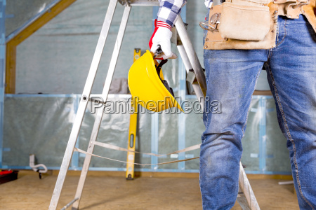 builder handyman with yellow safety helmet