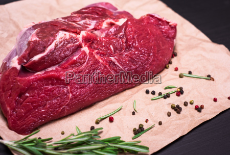 fresh piece of beef on brown