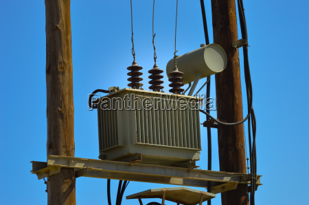 electric transformer on wooden pylons