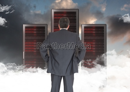 composite image of businessman standing looking