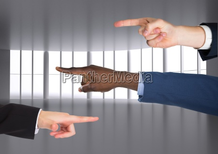 composite image of hands pointing blame