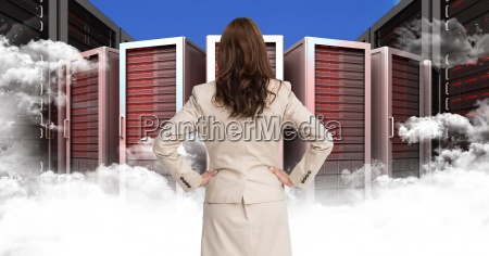 businesswoman standing looking at graphic with