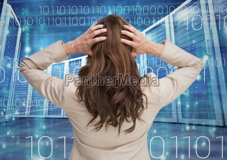 businesswoman standing and holding her head