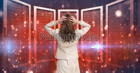 businesswoman standing holding her head and