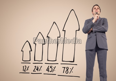 businessman standing in front of graph