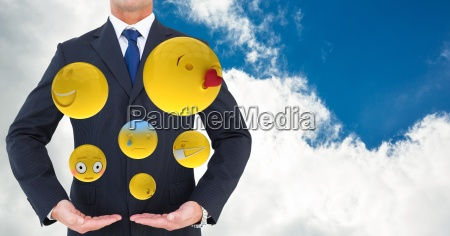 midsection of businessman with various emojis