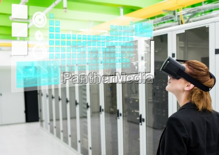 woman near servers wearing vr virtual