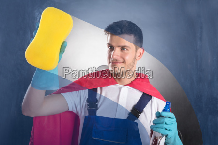 male janitor cleaning glass