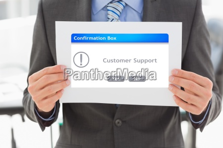 midsection of businessman holding confirmation box