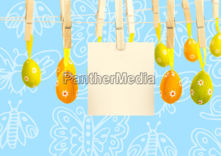 easter eggs with note on pegs