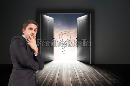 confused businessman standing with door and