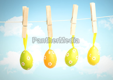 easter eggs on pegs in front