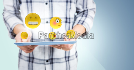 man mid section with tablet emojis