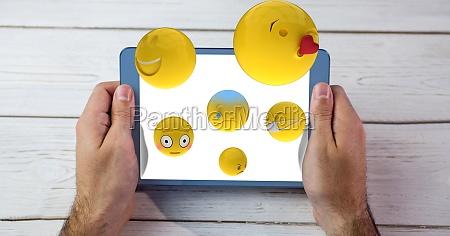 digitally generated image of emojis flying