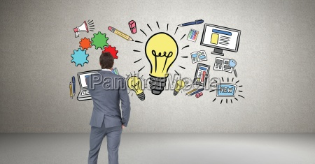 businessman looking at idea graphics