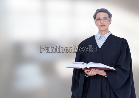 judge holding book in front of