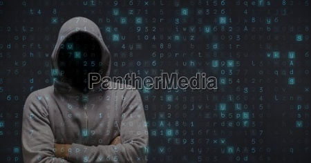 digital composite image of hacker standing