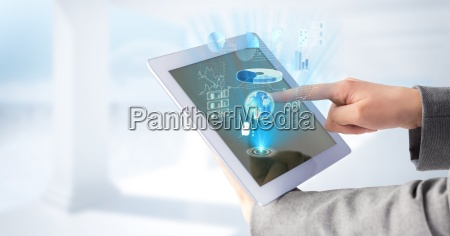 hands touching tablet and blue graphics