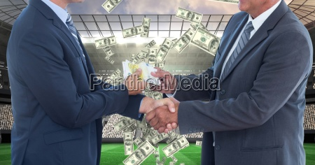 midsection of businessmen exchanging money while