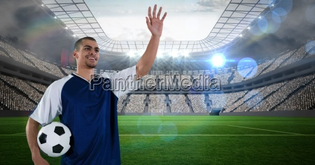 soccer player with ball waving hand
